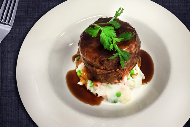 Slow cooked pulled beef fillet with market fresh vegetables  folded through creamy potato mash and cabernet jus