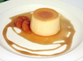 Classic Crème Caramel served with maple glazed mandarin