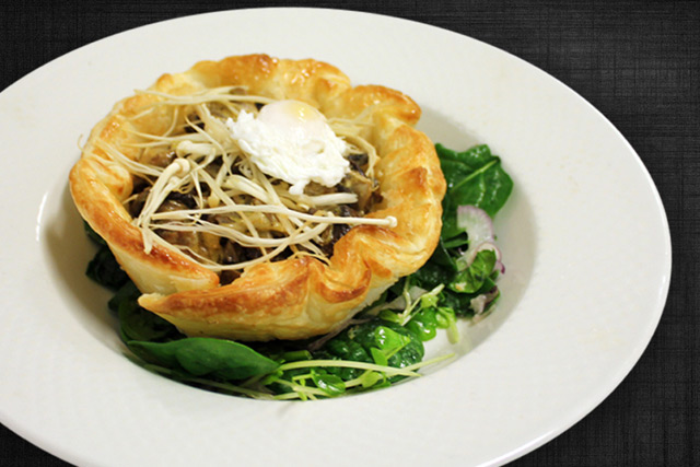 Tarte tatin of wild mushrooms, topped with free range quail egg,  pan-fried capers, celery and baby spinach salad